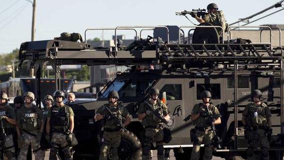 Police in riot gear in Ferguson, MO.